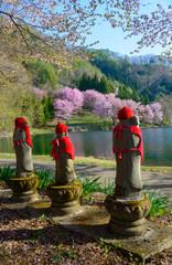 Jizo Bosatsu and Cherry blossoms on the Lake Nakatsuna in Omachi
