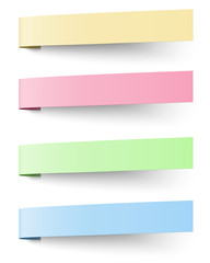 Yellow, red, blue and green sticky notes isolated on white