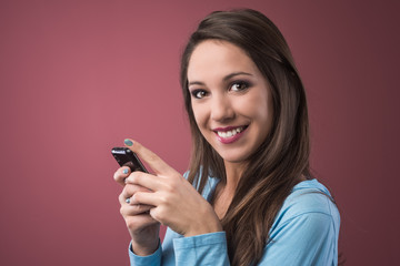 Smiling teenager with smartphone