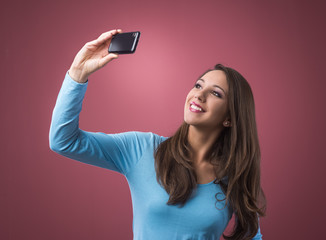 Girl taking selfies with her mobile