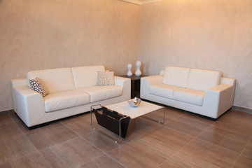 two white sofas and coffee table