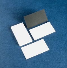 blank business cards on blue leather background