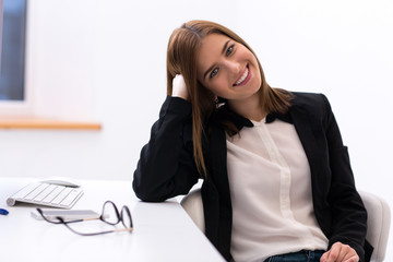 Attractive smiling woman sitting in the office