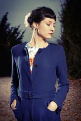 Woman in blue coat