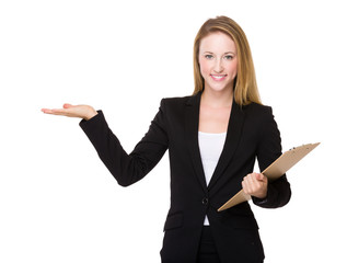 Businesswoman with clipboard and open hand palm