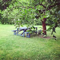 Wooden table in green summer garden