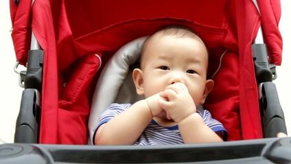 Asian Baby boy in stroller