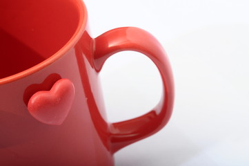 Red heart on red mug