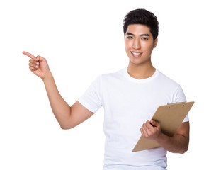 Asian Man hold with clipboard and finger point up