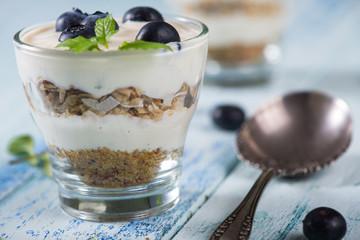 Fresh summer snack, blueberries yogurt and muesli