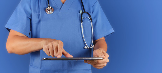Doctor working with tablet computeron blue  background