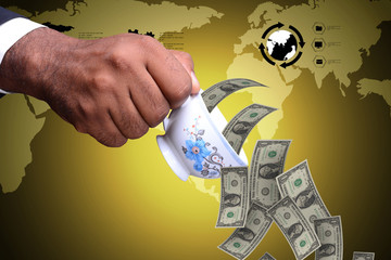 man hand with tea cup and currency notes