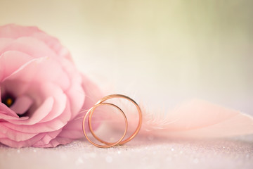 Wedding  Background with gold Rings and beautiful Eustoma rose f