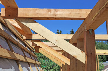 Installation of wooden beams at construction of the house
