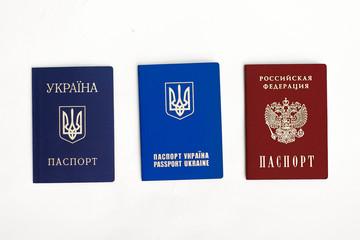 Ukrainian and Russian passports on white