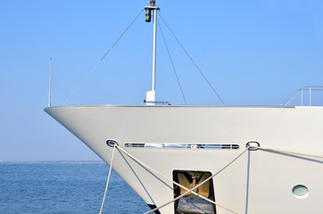 Bow of moored large white motor yacht