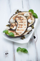 Grilled aubergines with capers, mozzarella and green basil