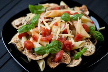 Italian pasta alla Norma. Close-up, horizontal shot