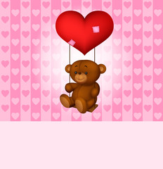 Toy teddy bear swinging on the balloon-heart