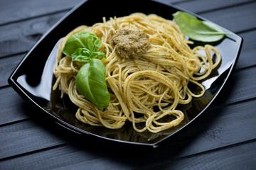 Still life food: spaghetti with basil pesto, studio shot
