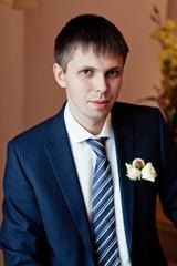 Portrait of handsome groom