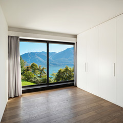 Home, empty room with wardrobes