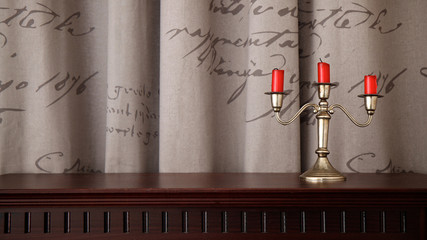 Candlestick and three red candles