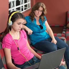 Mother looks at her internet addicted teen daughter