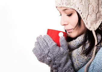 Girl in white knit cap with a red circle with pumponami hands is