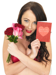Sexy Young Woman Wearing Red Lingerie and Holding Red Roses