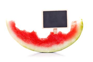 Half-eaten melon with blackboard