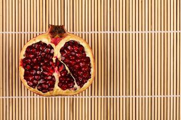 Half pomegranate on wooden sticks