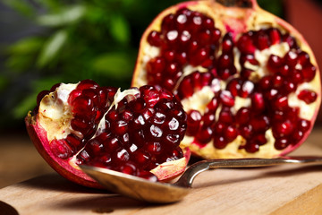 Pomegranate with silver teaspoon