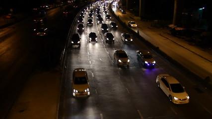 Highway driving busy traffic at night, tilt up shot