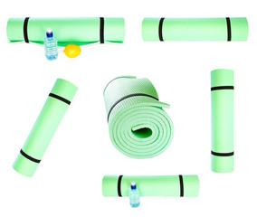 Set of Lightweight foam Yoga Mat roll isolated on white backgrou