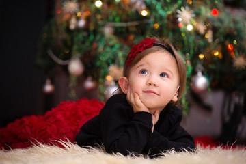 Baby Girl Under Christmas Tree