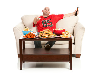 Fans: Man Watching TV wtih Lots of Food