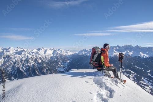 Leinwandbild Motiv Schneeschuhwandern in den Alpen
