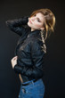beautiful sensual sexy girl blonde in a leather jacket
