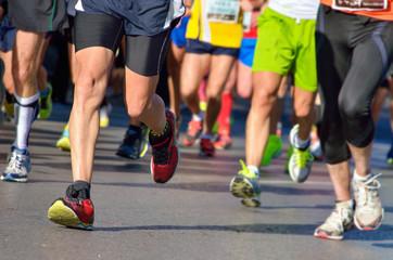 Marathon running race, people feet on road, sport concept