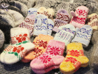 knitted woolen socks and mittens on the shelves