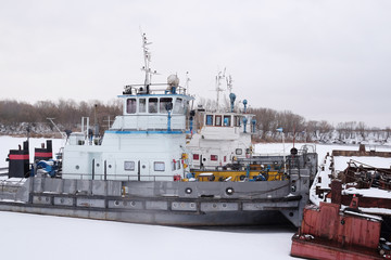 ships in the river port in winter