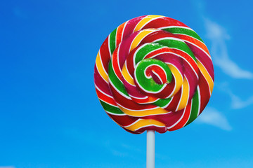 Colorful lollipop with blue sky background