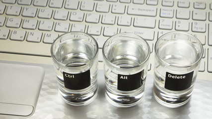 "Computer keyboard with ""Ctr-Alt-Delete"" command on 3 glasses"
