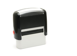 Mechanical office rubber stamp on a white background.