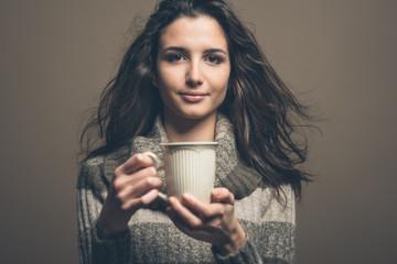 Beautiful woman having an hot drink