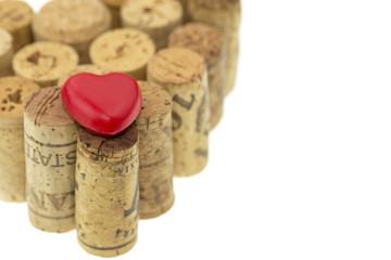 Red heart symbol on wine corks form a heart shape