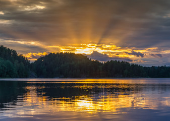 The rays of the sunset on Lake Ladoga. Reflection.