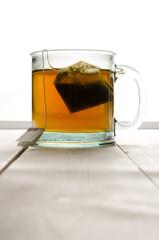 Cup of green tea portrait top center