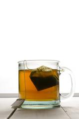 Cup of green tea portrait center backlit